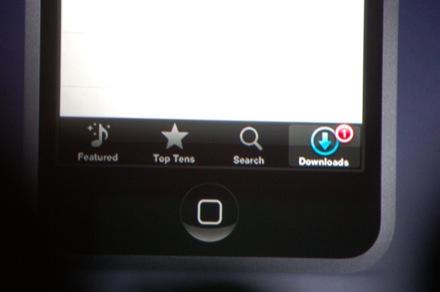 De knop Downloads laat na aankoop de voortgang van het binnenhalen van je aankoop zien.