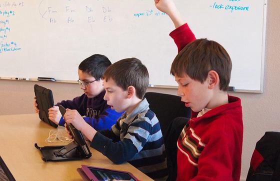 Kinderen met een iPad