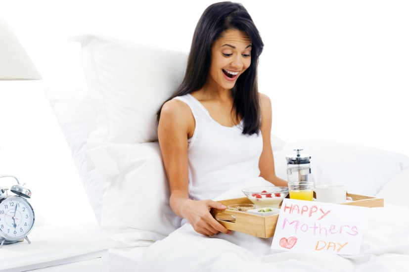 Happy mothers day breakfast in bed mum with card and tray of delicious food (c) Warren Goldswain/Shutterstock