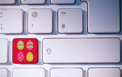 Easter eggs against red Apple key on keyboard