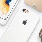 iPhone-accessoires in wit met goud.