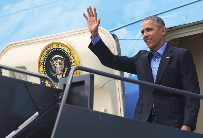 Obama in vliegtuig