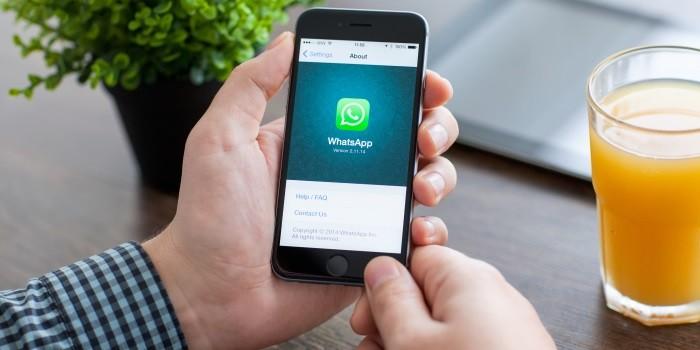 WhatsApp op iPhone met sinaasappelsap
