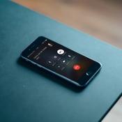 Telefoongesprek beantwoorden met automatisch bericht