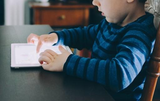 Game Center: kind met iPad