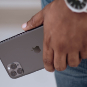 iPhone 11 Pro in hand van man