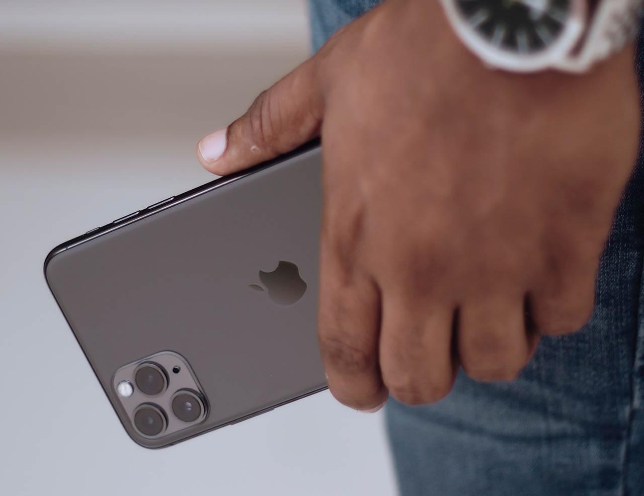 iPhone 11 Pro in hand van man